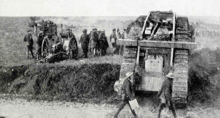 British tanks going forward to attack Bourlon Wood during the Cambrai fighting pass captured German guns