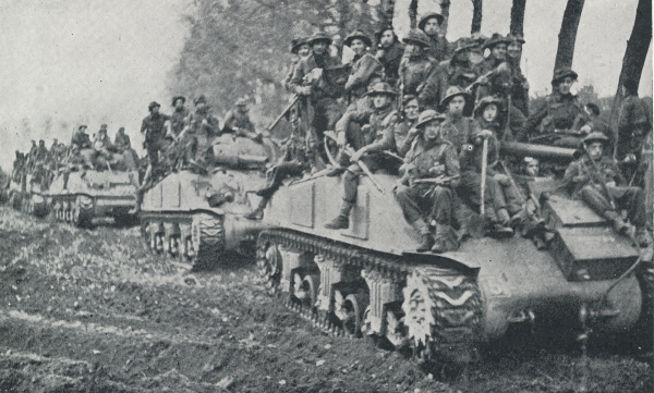 US Military Photos and Videos: - Page 3 British_troops_Ride_Sherman_tanks_Hertogenbosch