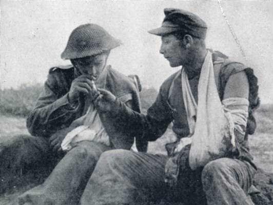 British wounded solider accepts cigarette from wounded German POW in Tunsisia