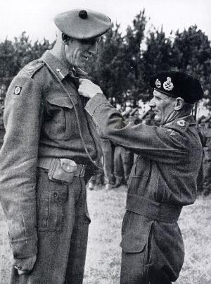 Field Marshal Montgomery decorating the tallest general in the British Army Major-General C M Barber with a Bar to his D.S.O.