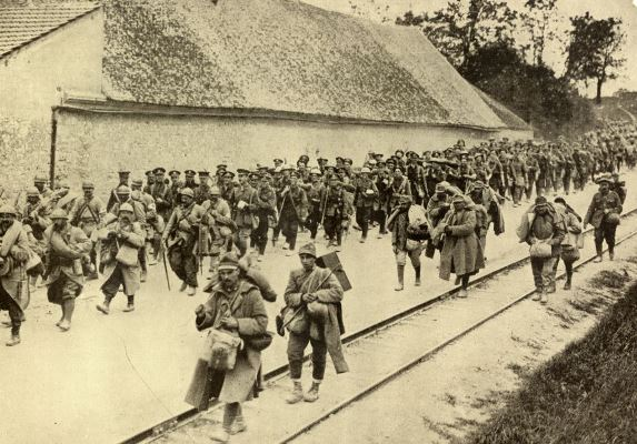 French and British troops marching back during the battle of the Aisne photo taken on May 29th 1918 at Passy-sur Marne