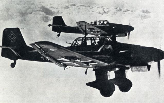 German JU 87 dive-bombers, which have been used extensively in land battles, against ships at sea and against open towns