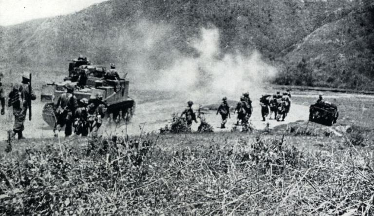 Gurkhas and men of the West Yorkshire Regiment advance under cover of forward tanks in the Kohima-Imphal area on the Burma Front.