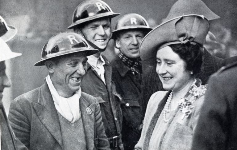 HM the Queen in conversation with a smiling man of a London rescue party