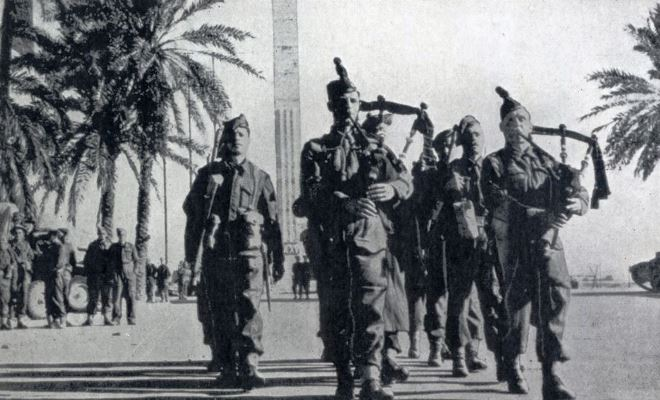 Men of the Gordon Highlanders, with pipes playing, marching into Tripoli on 23rd January 1943