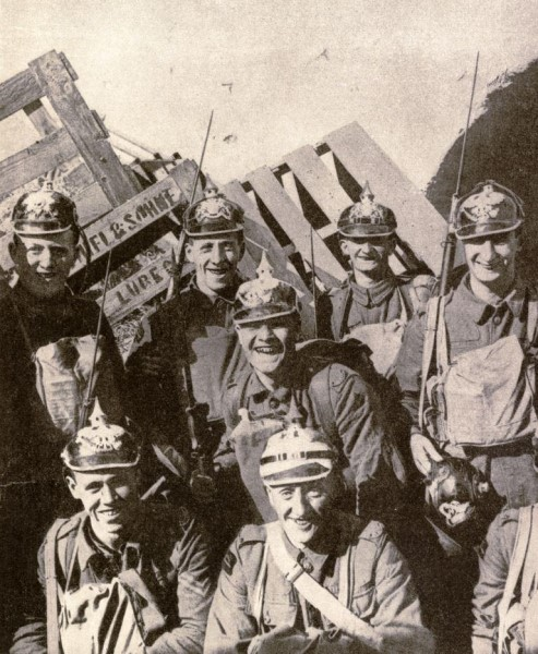 Men of the Loyal North Lancashire Regiment wearing Pickelhaube, German Army helmets, picked up while on patrol duty during the battle of Cambrai Oct 1918