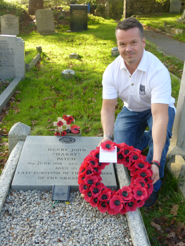 Neil White, Web Manager for Forces War Records, lays a wreath on the grave