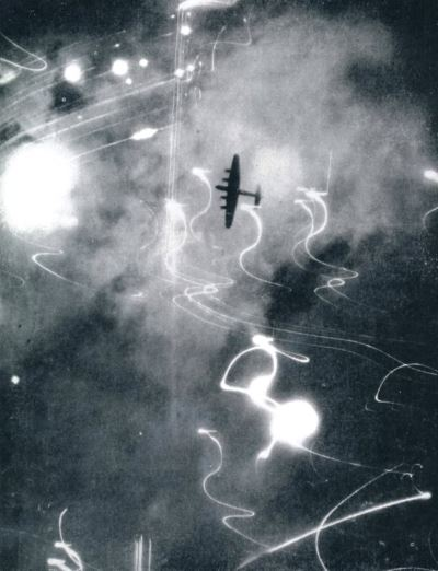 RAF Avro Lancaster amidst flak tracer over Hamburg 30th January, 1943