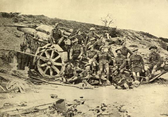 Scotsmen from Canada posing for their photograph on a captured gun on August 10th 1918