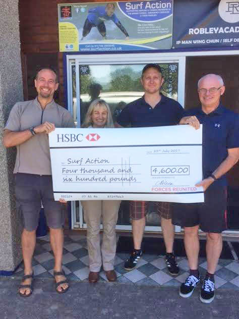 Surf Action with Forces Reunited cheque for £4,600