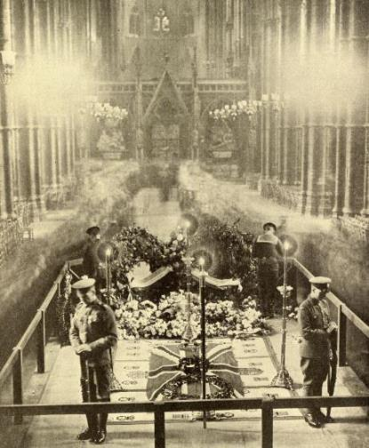 The grave of the Unknown Warrior in Westminster Abbey with a guard of honour representing the Army, Royal Navy, Royal Air Force and the Marines standing sentry over it.