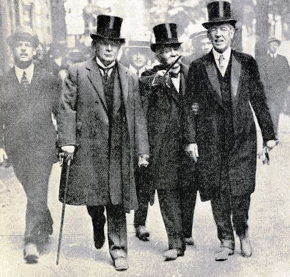 Three statesmen who dictated the terms to Germany, Mr Lloyd George, M Clemeceau and President Wilson on their way to sign the Peace Treaty at Versailles June 28th 1919