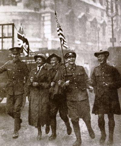 Unofficial Victory March on November 11th 1918 celebrating the Armistice English, Scottish, Australian and Canadian soldiers with a woman war-worker in the Strand, London