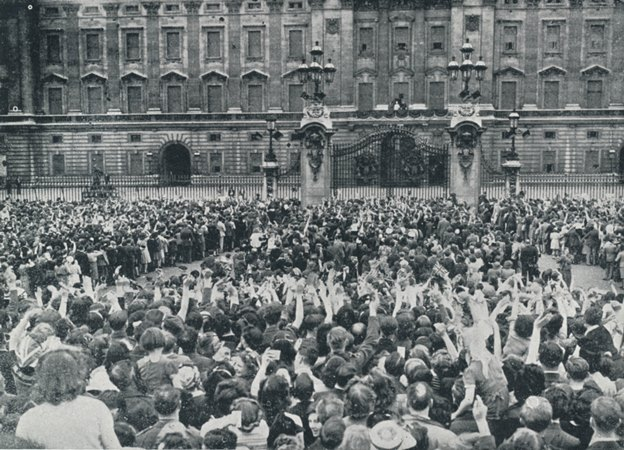 VE Day crowds greet the Royal Family at Buckingham Palace