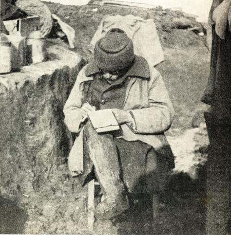 Writing a letter home from a trench at Grand Flamengrie Farm February 1915, Captain H E Lee of a Scots Regiment