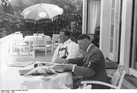 Hitler relaxing with Hermann Göring, Obersalzberg, Picture via Creative Commons. Attribution: Bundesarchiv, Bild 183-2004-1202-502 / CC-BY-SA
