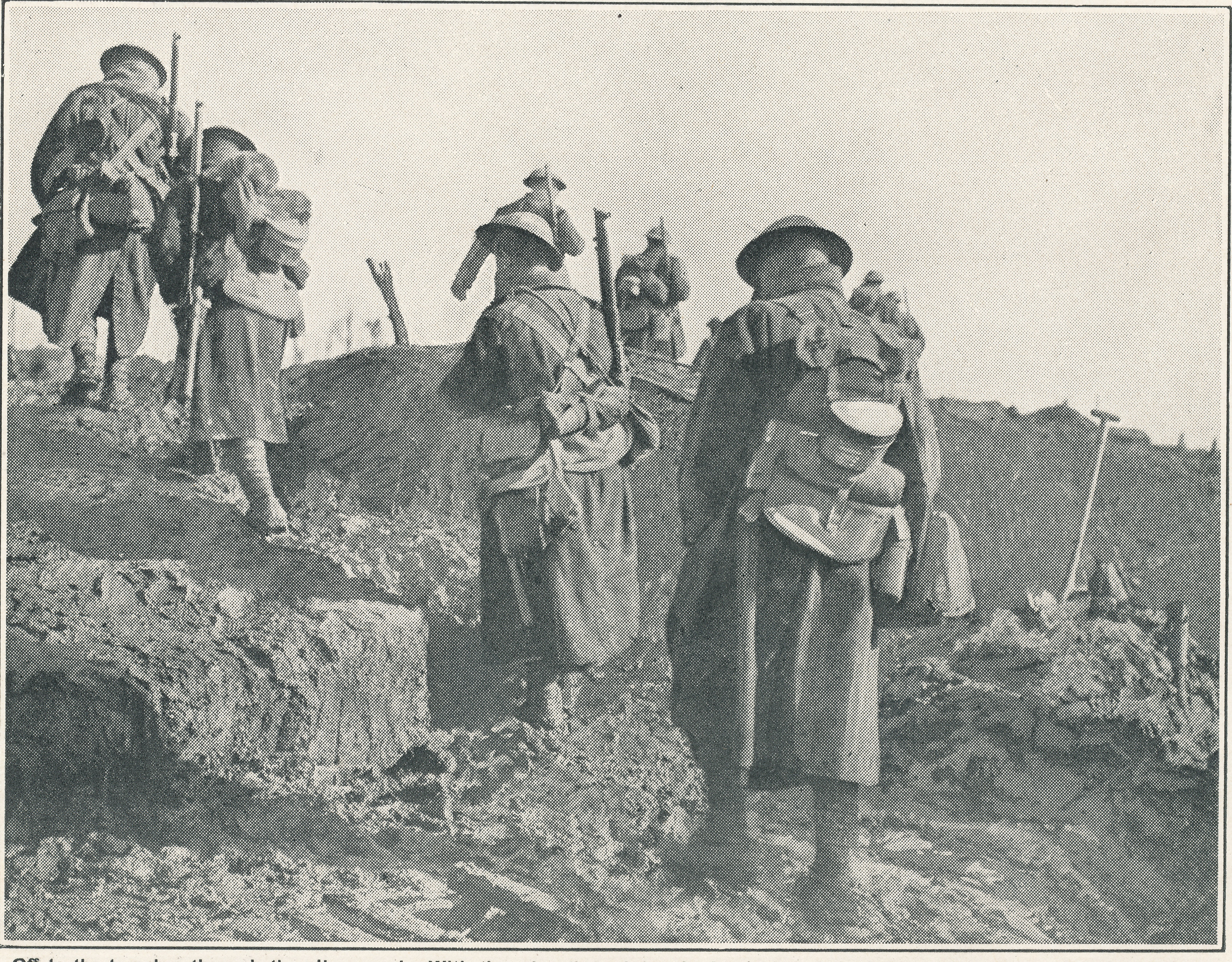 British soldiers walking through the trenches of WWI. Picture from the Forces War Records library.