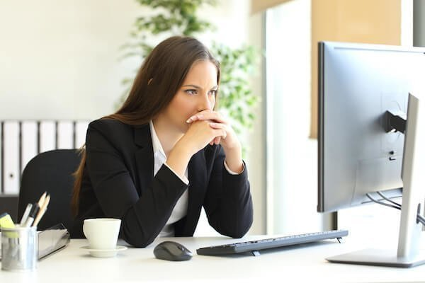 businesswoman staring at computer.jpg