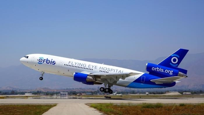 Md 10 2016 C Orbis N Asia Left Side Whole Plane Exterior Takeoff