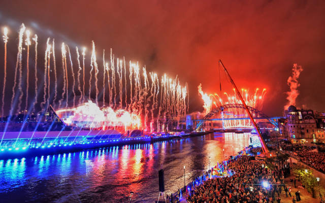 Great North Star - A large crowd on the banks of the River Tyne watching a fireworks display.