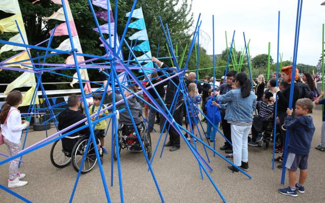 Liberty 2017, Stalker Teatro. Young people in wheelchairs interact with a giant colourful stick installation.