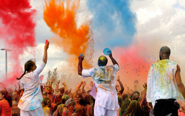 Colour of Time, Artonik, East London Dance, GDIF 2015. Three artists release coloured powder over a crowd, evoking Holi festival.