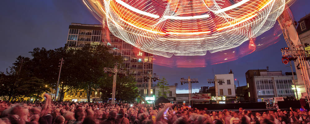 Cristal Palace by Transe Express, Opening Night GDIF 2019. A giant chandelier spins above a crowd in Woolwich.