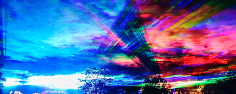 Borealis, Dan Acher, GDIF 2021, Greenwich. COlourful lights fill the sky.