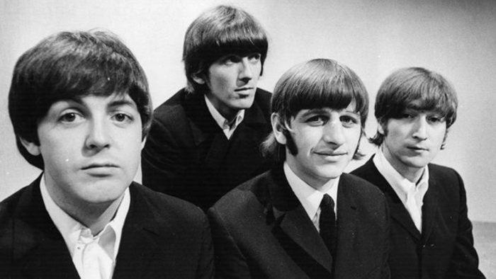 The Beatles face the music
