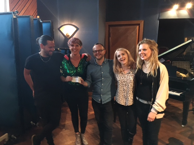 She Drew The Gun collect The GIT Award 2017 cheque from Getintothis' Peter Guy at Parr Street Studios