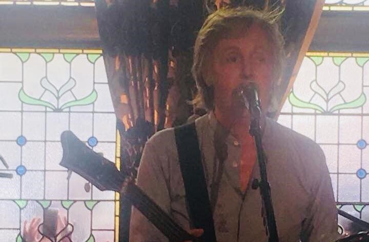 Paul McCartney performing a surprise set in the Philharmonic Pub