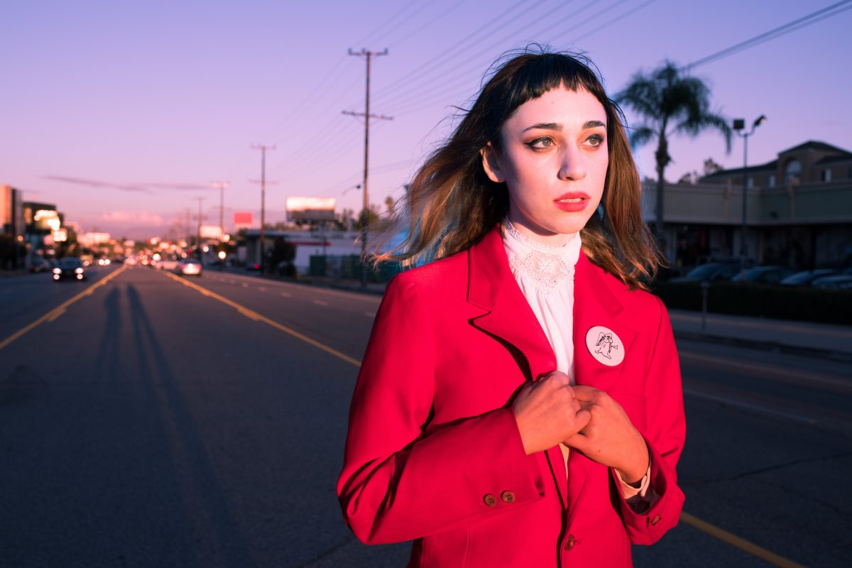 Jackie Cohen in a red jacket
