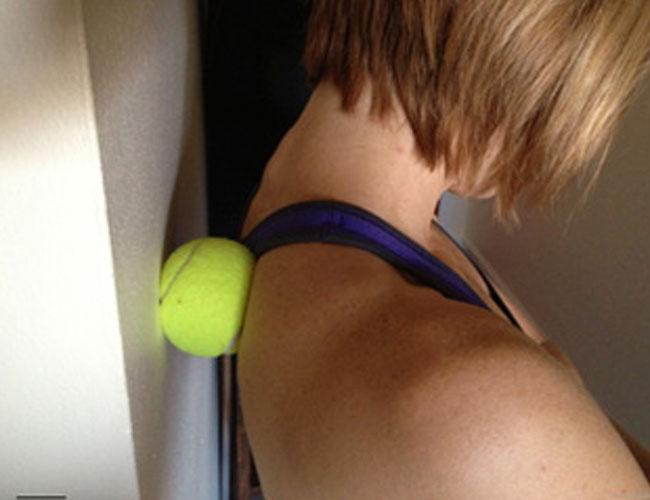 Tennis ball shoulder stretch for stress