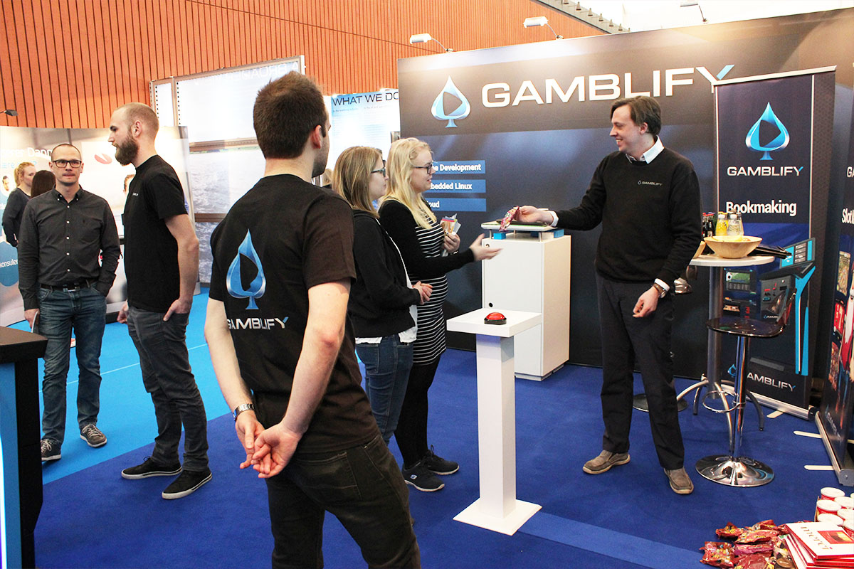 dse job expo gamblify dennis giving out prizes from the wheel of fortune game