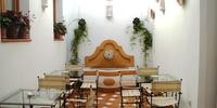 Cuatro casitas de muñecas, Hospedería El Churrasco