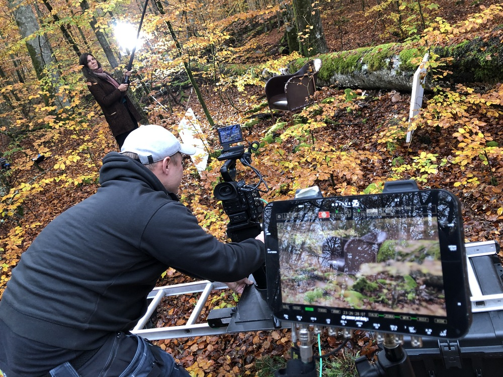 Forest studio set up in Helgö, Växjö. Interior Cluster's Christine Ingridsdotter helped the filmteam to shake some leafes into the armchair scene while camera was tracking sideways.