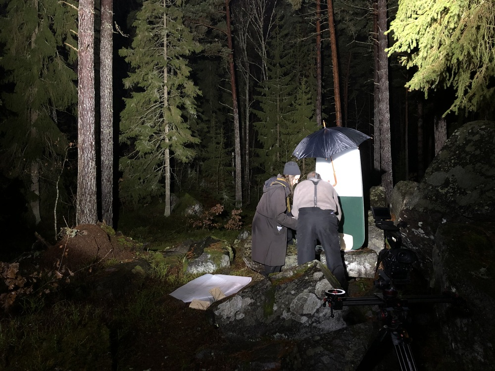How to film a write board in the forest? In night time, with a big spotlight and smoke of course. And a tracking camera.