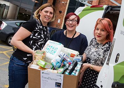 Staff delivering food to local food banks