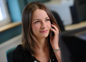 Member of staff on the phone