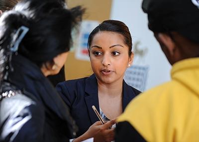 Staff giving advice to customers