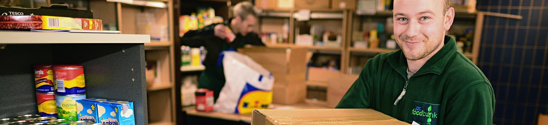 A volunteer working in a Trussell Trust food bank