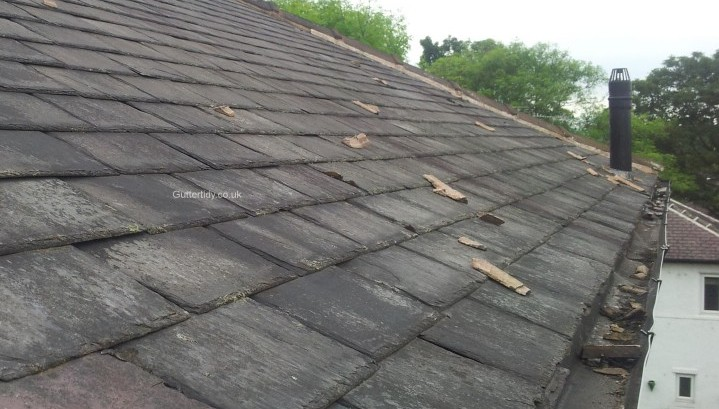 roof and gutter with loose mortar.