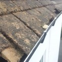 gutter with roof tiles slipped into it