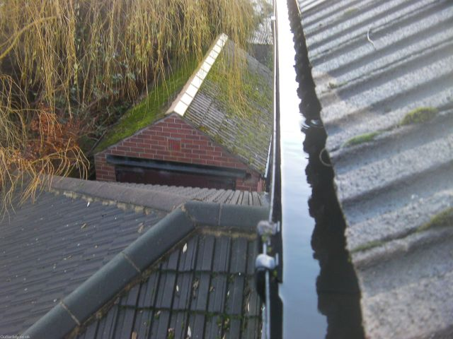 Gutter above extension has been cleared and flushed clean.