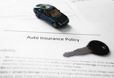 Car insurance document and key