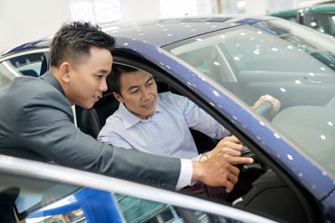 Car salesman showing customer dashboard