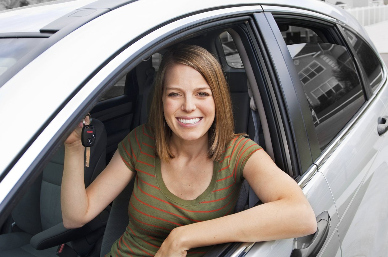female_driver_holding_car_keys