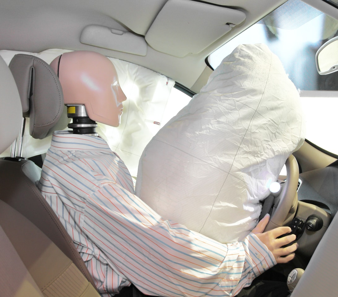 Testing driver's airbag with crash test dummy