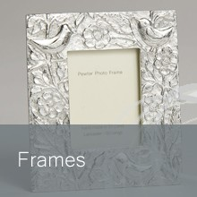Pewter frames by Lancaster & Gibbings, handcrafted in England. Display your photos in style.