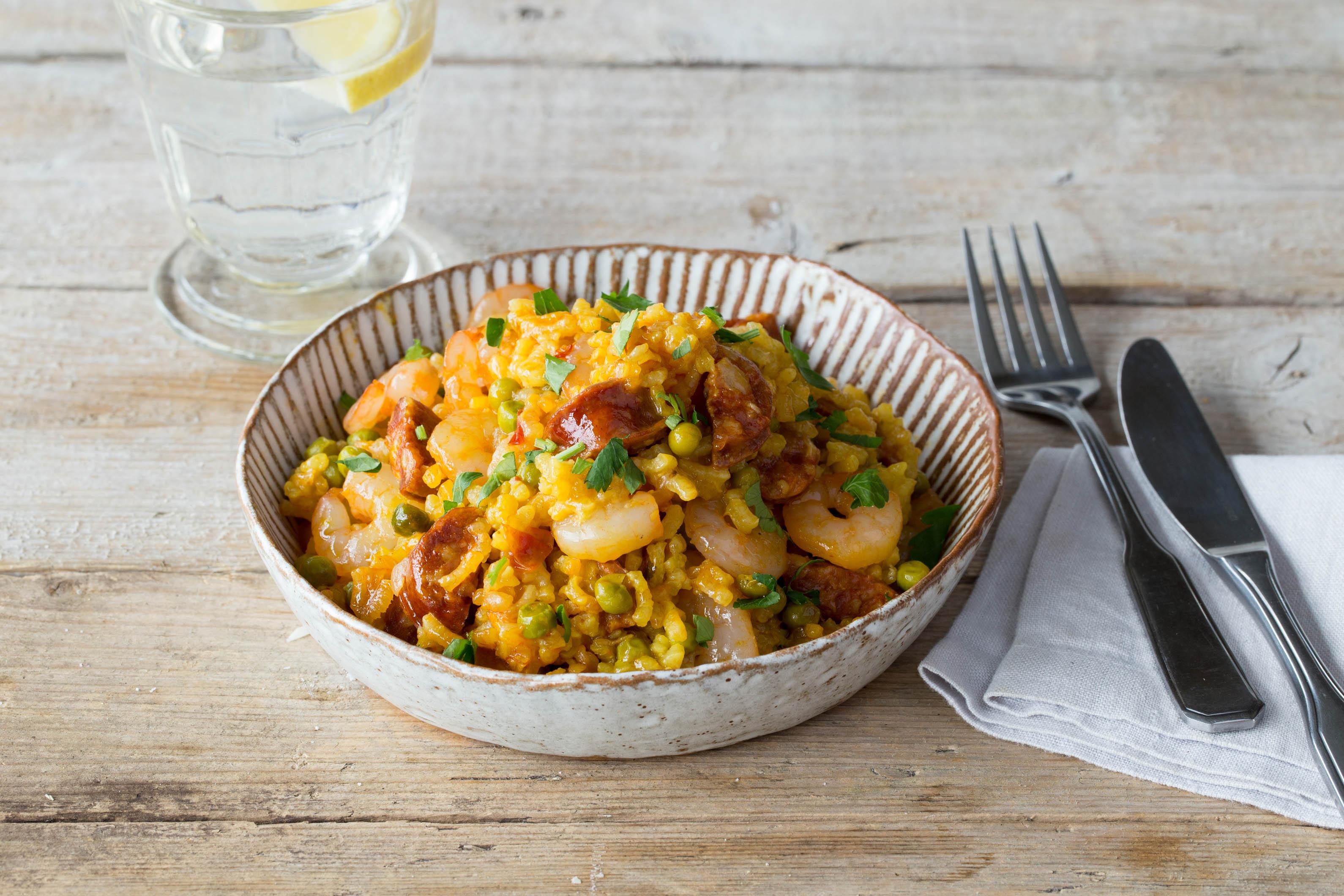 Shrimp and Chorizo Paella with Saffron, Smoked Paprika, and Peas
